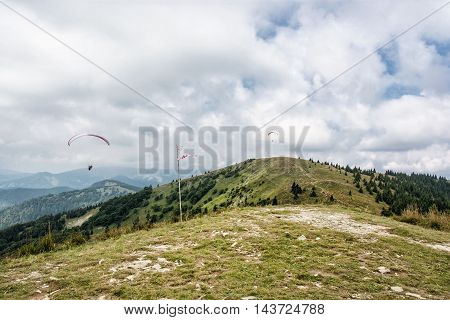 Paragliding Donovaly mountains scene Slovak republic. Leisure activities. Seasonal natural theme. Beauty in nature. Adrenaline sport.