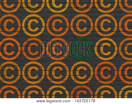 Law concept: rows of Painted orange copyright icons around green copyright icon on Black Brick wall background