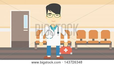 An asian male doctor holding first aid box. Doctor in uniform with first aid kit standing in the hospital corridor. Vector flat design illustration. Horizontal layout.