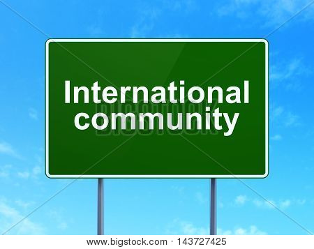 Politics concept: International Community on green road highway sign, clear blue sky background, 3D rendering