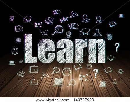 Learning concept: Glowing text Learn,  Hand Drawn Education Icons in grunge dark room with Wooden Floor, black background
