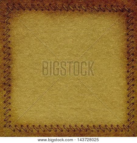 Gold crumpled paper with frame in the form of binding background texture for your message