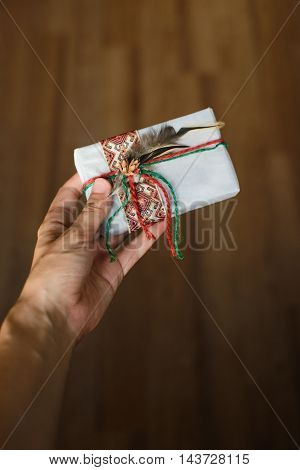 woman's hand gives or get a holiday gift
