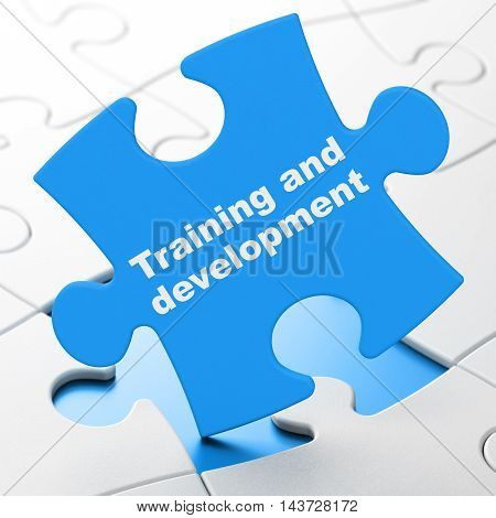 Studying concept: Training and Development on Blue puzzle pieces background, 3D rendering