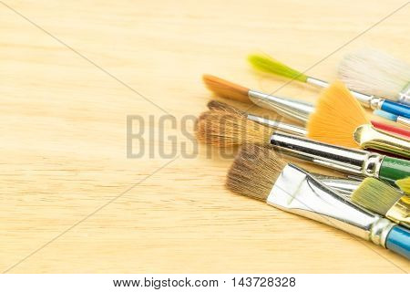 Group Of Watercolor Brush On Wood Table ,copy Space For Adding Your Content