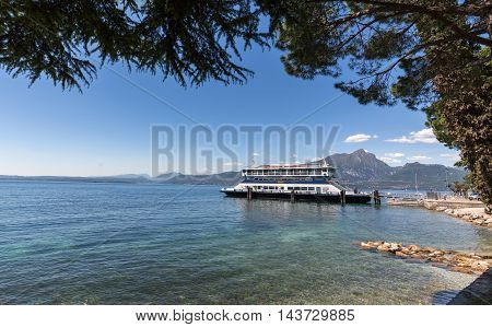 TORRI DEL BENACO, ITALY - MAY 4, 2016: boat on Lake Garda. Garda Lake is one of the most frequented tourist regions of Italy.