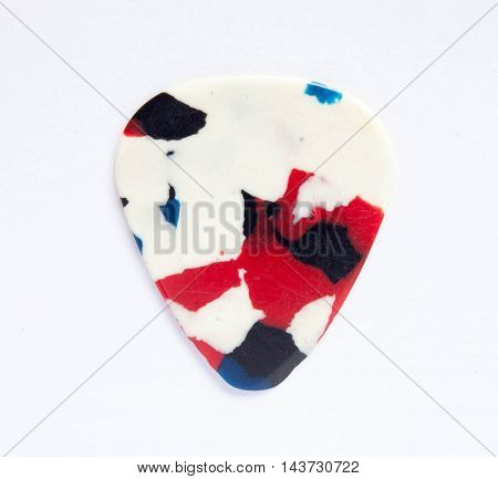 Guitar pick isolated on white background , Close up