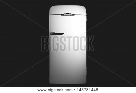 Very old fridge on a black background