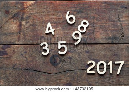 New year symbol. Set of wooden digits as 2017 on wood background