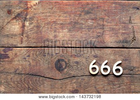 666 sign on old wooden background with free space