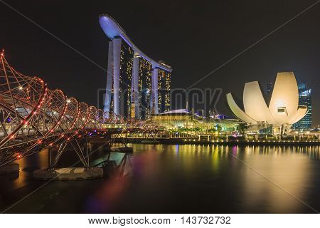 SINGAPORE SINGAPORE - SEPTEMBER 28 2013 : Singapore skyline and view of Marina Bay Sands luxury hotel which located near Helix bridge a famous landmark of Singapore.