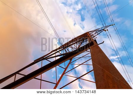 the old line of electric transmission / vivid evening the picture on the background of the colorful sky