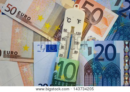 Thermometer and euros - Finance / Business concept