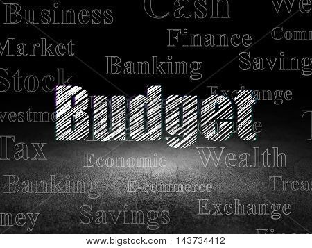 Money concept: Glowing text Budget in grunge dark room with Dirty Floor, black background with  Tag Cloud