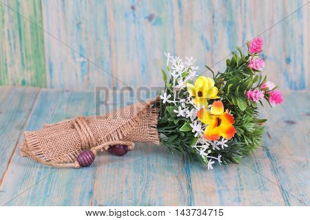 beautiful Bouquet of flowers on old wood table