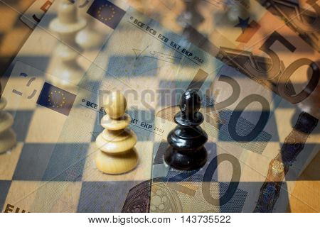 Chess figures and money - Business concept