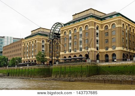 LONDON ENGLAND - JULY 8 2016: View from Thames river of the public open air Hay's Galleria. Originally a warehouse it was converted to a major visitor attraction in the 1980s.