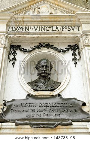 LONDON UK - JULY 8 2016: Memorial bust to Sir Joseph Bazalgette set into the wall of the Thames Embankment. He is the engineer of the London main drainage system.