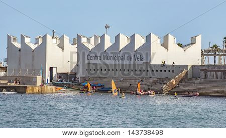 BARCELONA SPAIN - JULY 4 2016: The Municipal Sailing Centre is located in Barcelona Port Olimpic next to the beach. Nautical offers various courses - sailing catamaran windsurfing etc.
