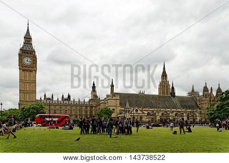 LONDON ENGLAND - JULY 8 2016: Big Ben and the Houses of Parliament Westminster Palace seen from the Parliament square. It is one of London's top tourist attractions.