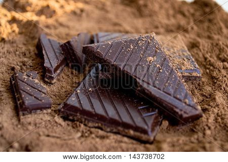 Dark chocolate with cocoa powder, surface patterns