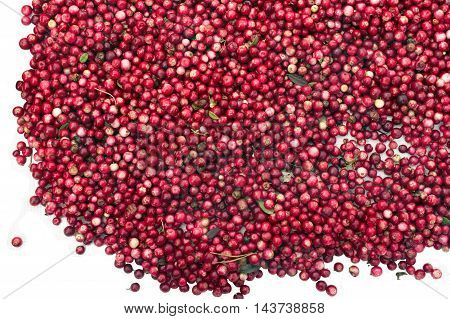 Overhead shot of just picked up red berries isolated on white