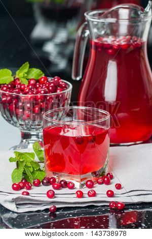 Fresh cranberry juice with mint on black background