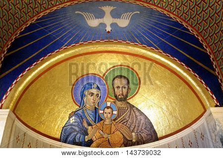 LONDON ENGLAND - JULY 8 2016: Mosaics depicting the Holy Family of Jesus Mary and Joseph in the Chapel of St. Joseph in Westminster Cathedral. The Chapel is dedicated to the husband of Mary Joseph.