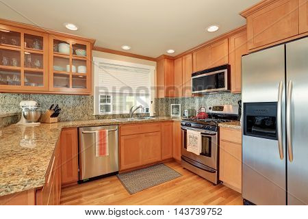 Bright Wooden Kitchen Interior With Steel Appliances