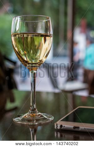 picture of close up  glass of wine in restaurant, blur background