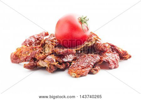 Fresh and dried tomatoes isolated on white background.