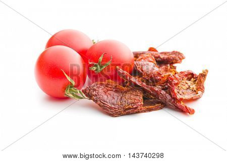 Dried and fresh tomatoes isolated on white background.