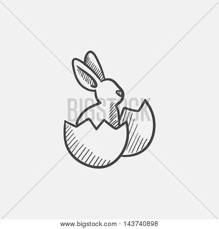 Easter bunny sitting in egg shell sketch icon for web, mobile and infographics. Hand drawn vector isolated icon.