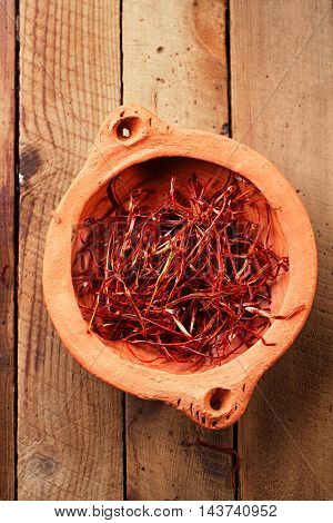 extra hot red chili pepper strings, threads in clay bowl