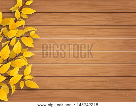 Autumn tree branch with yellow and  leaves on weathered wooden background.