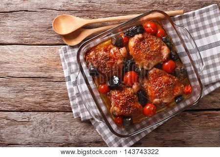 Chicken Thigh Baked With Tomatoes And Porcini Mushrooms Close Up. Horizontal Top View