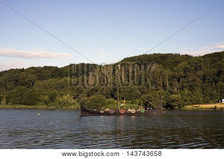 FAARUP VEJLE DENMARK - AUGUST 22 2016: Replica of Viking Ship - Jellingorm - Ship in Faarup Lake Denmark. August 22 2016.