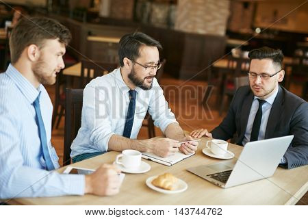 Coworkers Working in Cafe