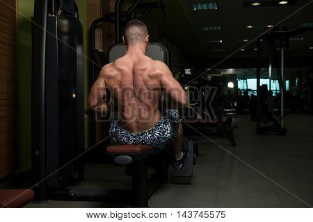 Back Exercise On Machine In Gym