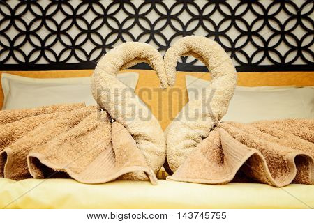 Bed suite decorated with towels in arabic style hotel
