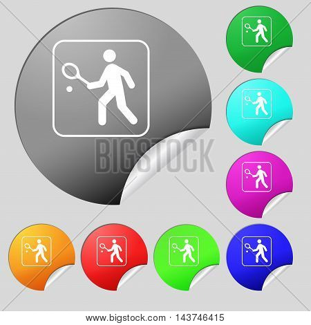 Tennis Player Icon Sign. Set Of Eight Multi Colored Round Buttons, Stickers. Vector