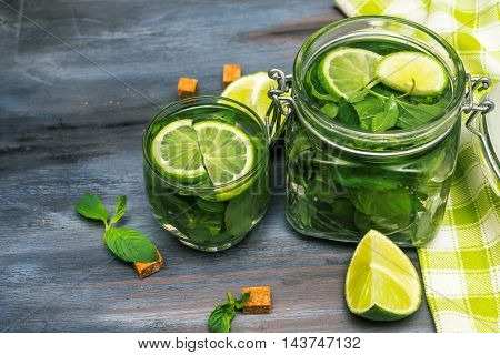 Glasses with mojito on wooden background. mojito with lime and mint.