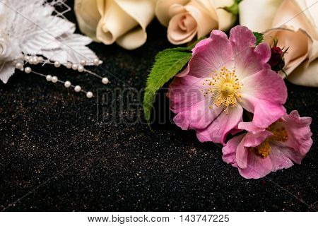 Wedding background with brier and pink rose