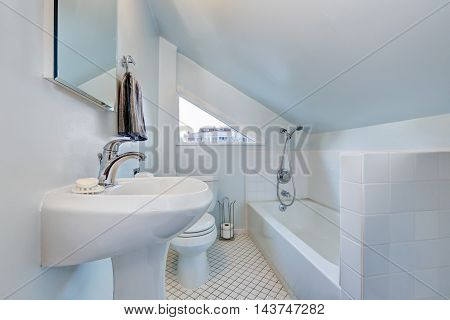 White Attic Bathroom Interior With Vaulted Ceiling.