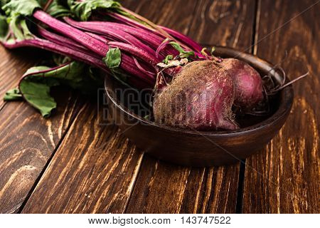 fresh beetroots on rustic wooden background. diet cooking.