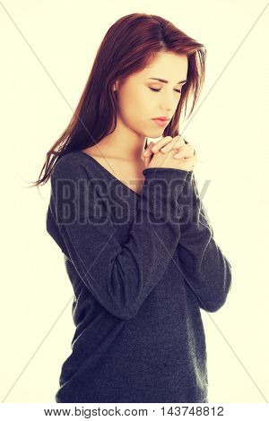 Woman praying with her hands together