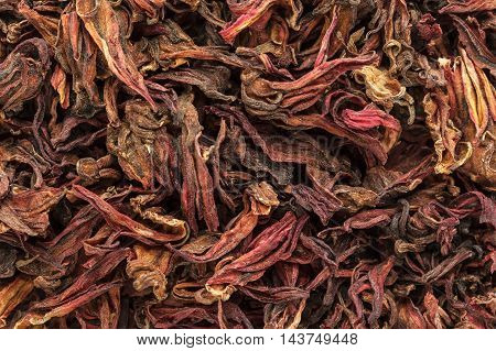 Organic dry Roselle (Hibiscus sabdariffa) leaves. Macro close up background texture. Top view.