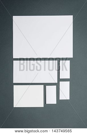 Mock-up business template with cards, papers on Gray background.
