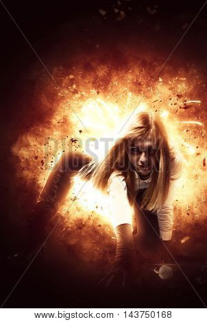 Female rock singer over blazing explosion background