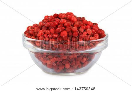 red peppercorns seeds isolated on white background
